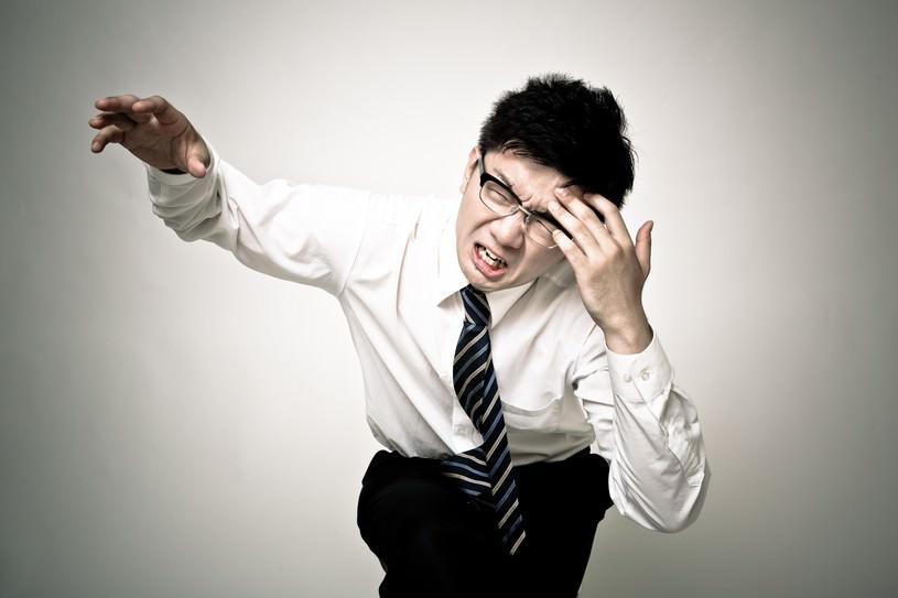 頭痛が痛い会社員
