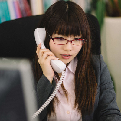 「仕事ができる事務の女性」の写真素材