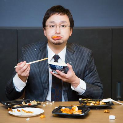 「食べ方が汚いビジネスマンは嫌われます」の写真素材