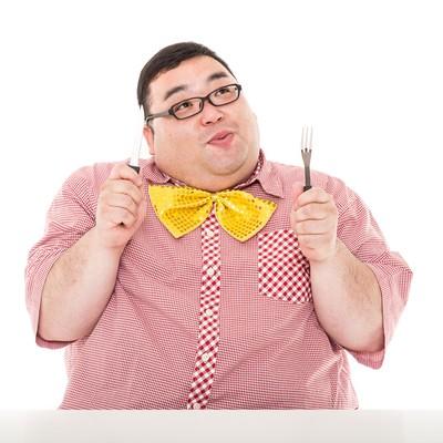 「おれ、この仕事終えたら飯を食うんだ。 #脂肪フラグ」の写真素材