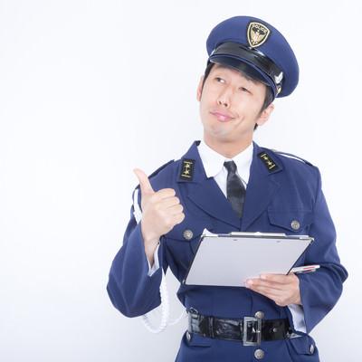 「「チャリあっちとめて」と横柄な態度をとる警官」の写真素材