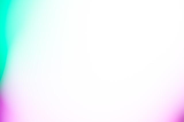 緑と紫の明るい光源(ボケ)の写真