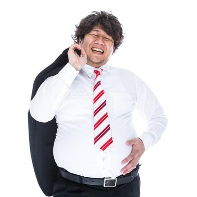 「大量のカロリーを摂取し満面の笑みで職場に戻る係長」の写真素材
