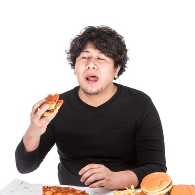 「100枚目のピザにうんざりしている大食いファイター」の写真素材