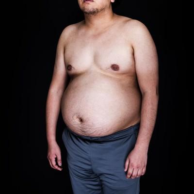 「肉体改造を妄想中の肥満児」の写真素材