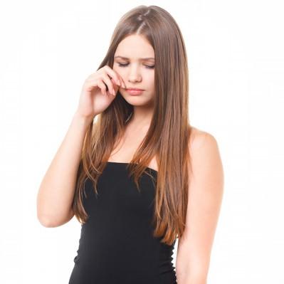 「悲しくて涙する女性」の写真素材