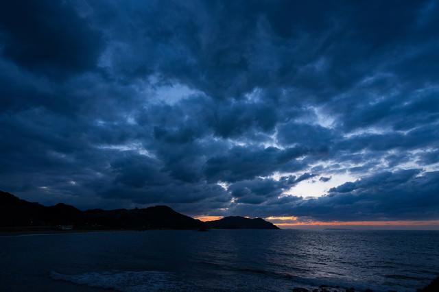 日が沈むの写真