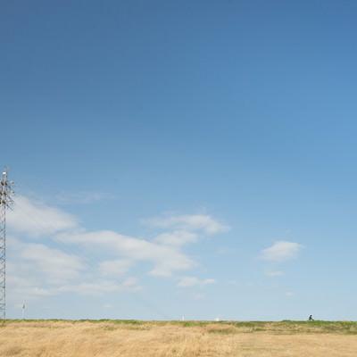 「河川敷と鉄塔」の写真素材