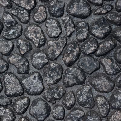 「ゴツゴツした石壁のテクスチャー」の写真素材