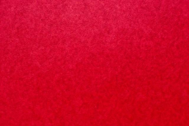 赤い紙のテクスチャーの写真
