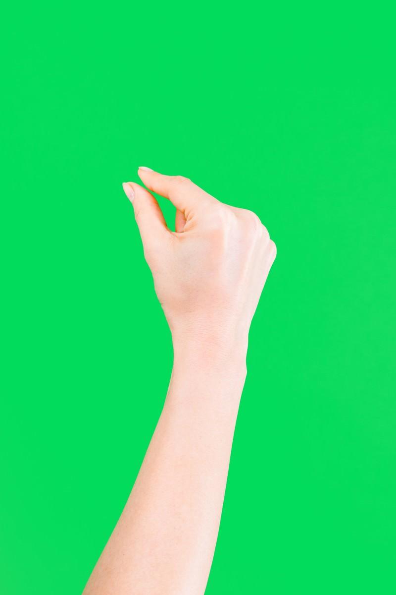 「ピンチイン(グリーンバック)ピンチイン(グリーンバック)」[モデル:MOA]のフリー写真素材を拡大
