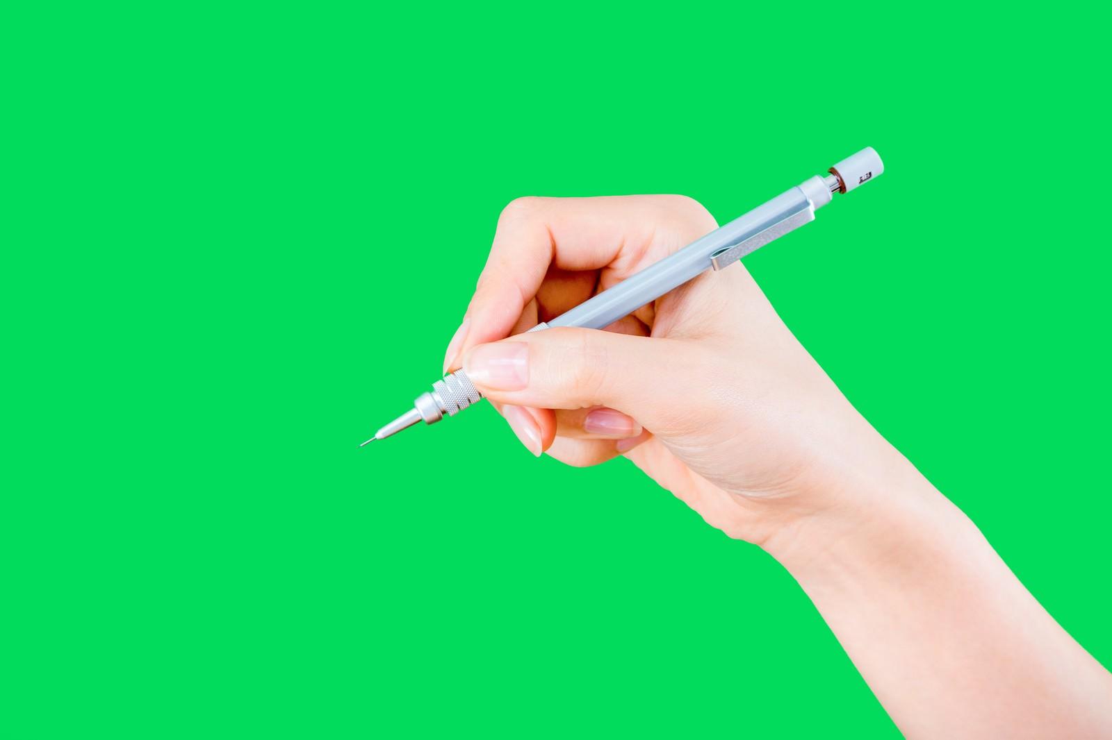 「シャーペンをもつ手(グリーンバック)シャーペンをもつ手(グリーンバック)」[モデル:MOA]のフリー写真素材を拡大