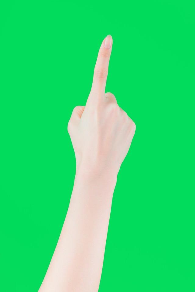 人差し指でタップする(グリーンバック)の写真