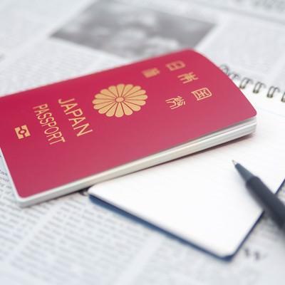 「パスポートとメモ帳」の写真素材