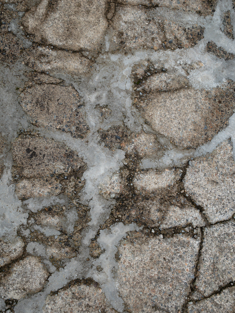 「セメントで補修された地面(テクスチャ)」の写真