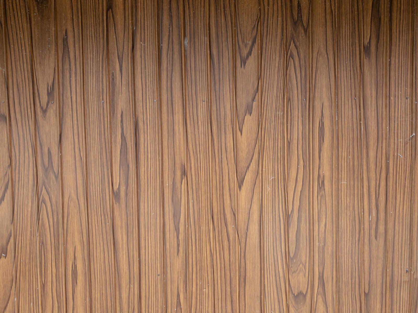 「影が入った木目調の壁(テクスチャ)」の写真