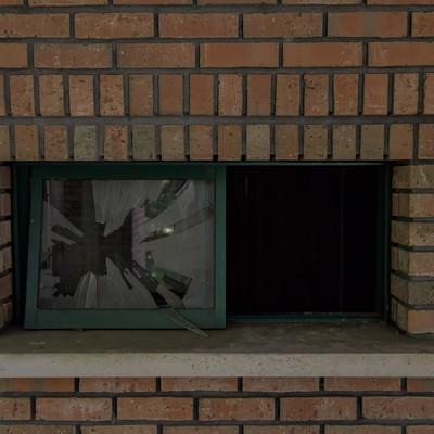 「レンガと割れたガラス窓」の写真素材
