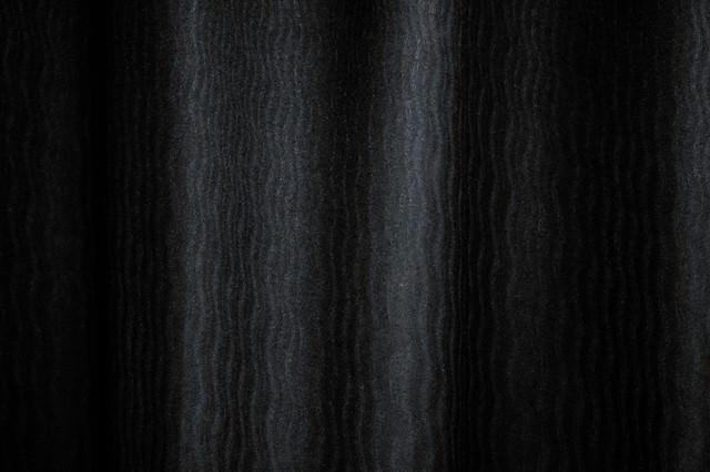薄暗い波模様(テクスチャ)の写真