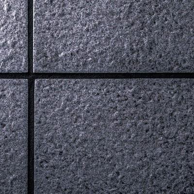 「暗いタイルの壁」の写真素材