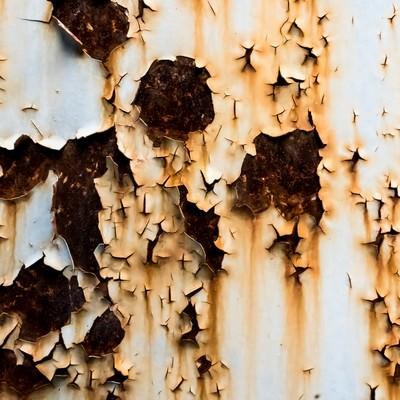 「塗装がはがれ錆びた壁(テクスチャー)」の写真素材