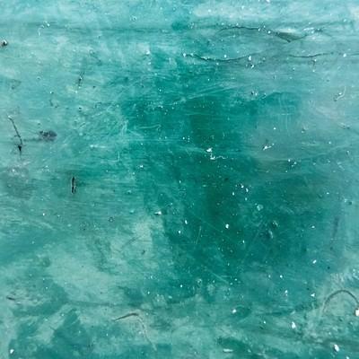 汚れた緑色の壁の写真