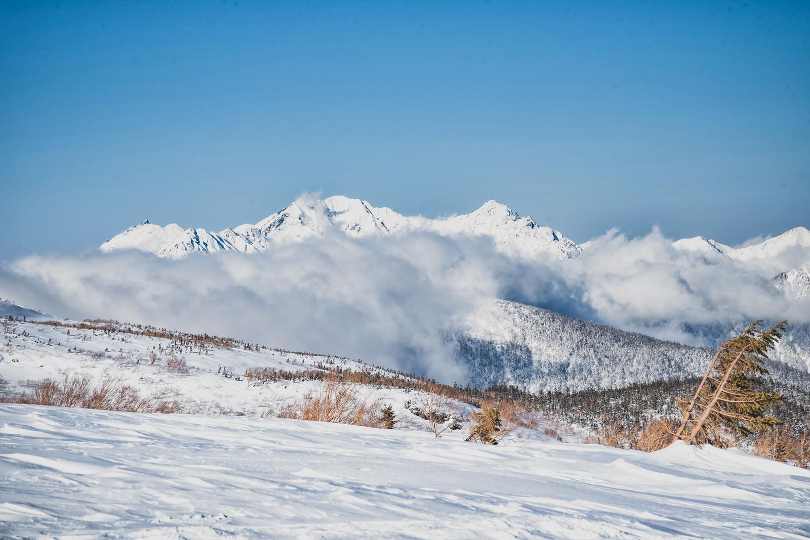 「雲に巻かれる穂高連峰(飛騨山脈)」の写真