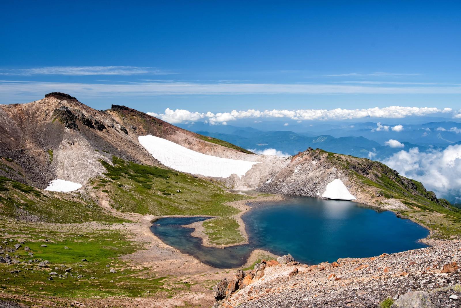「雪解けの水が溜まる権現池」の写真