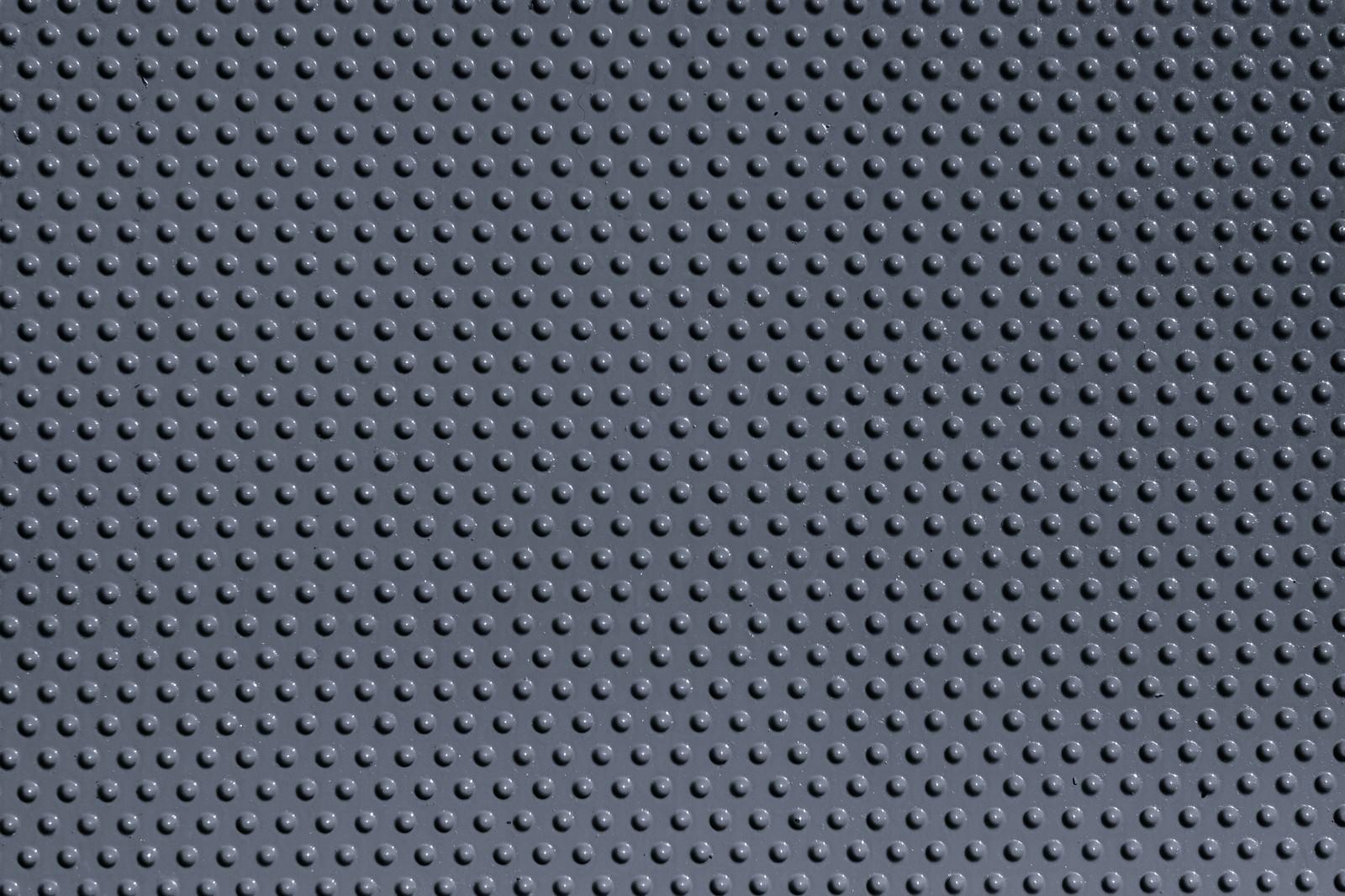 「細かい粒の集合したプラスチック板(テクスチャ)」の写真