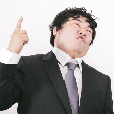 「過激な発言で世間の注目を集めるビジネスマン」の写真素材