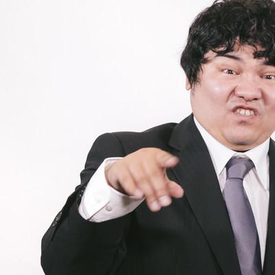 「馬鹿にした態度をとるビジネスマン」の写真素材