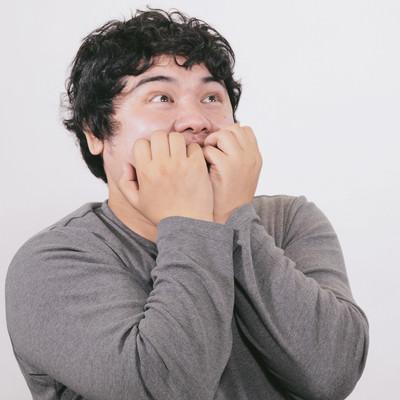 「何かを見てワクワクが止らない肥満」の写真素材