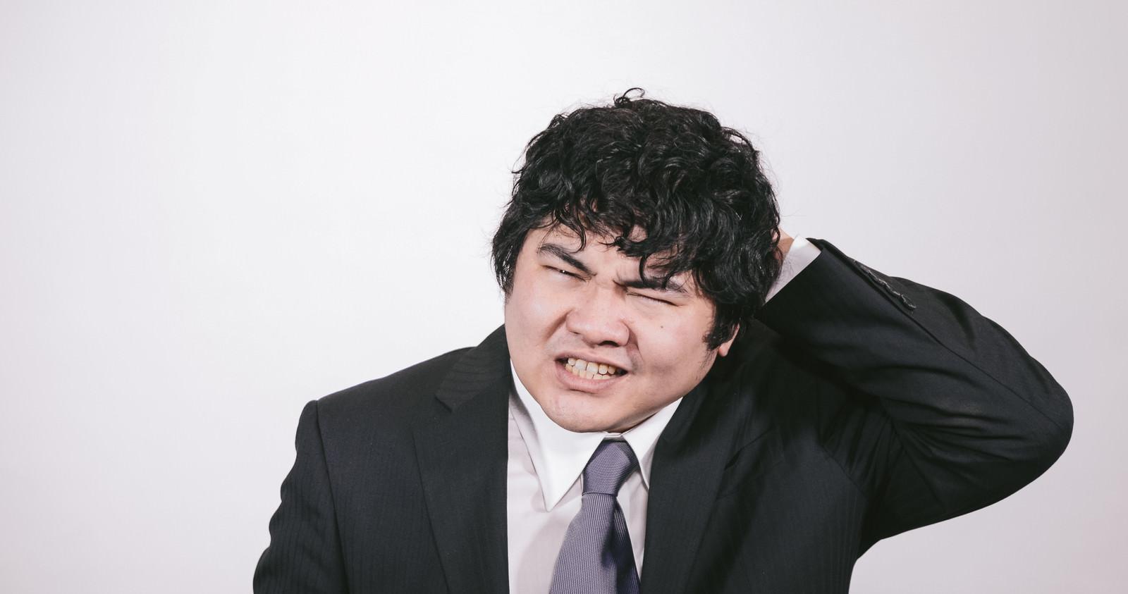 「失敗ばかりの会社員失敗ばかりの会社員」[モデル:段田隼人]のフリー写真素材を拡大