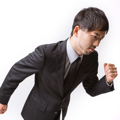 「ダッシュする(走り出す)サラリーマン」の写真素材