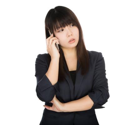 「部下の失態に呆れる女性上司」の写真素材