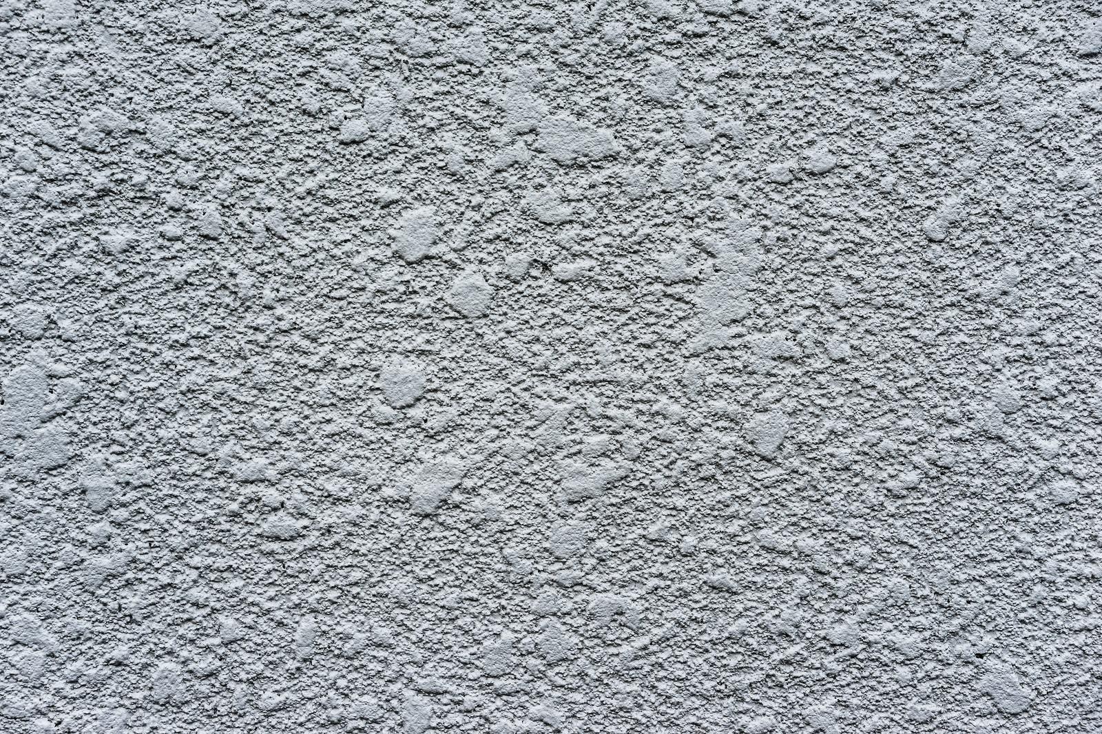 「あらいペンキが塗られた白い壁(テクスチャー)」の写真