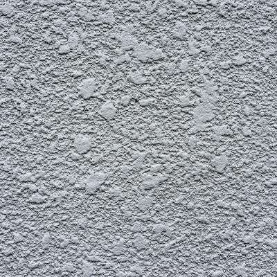あらいペンキが塗られた白い壁(テクスチャー)の写真