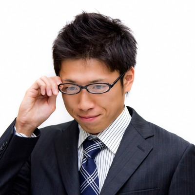 「眼鏡をかける男性」の写真素材