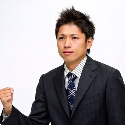 「手ごたえを感じるビジネスマン」の写真素材