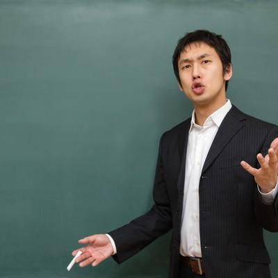 「いつやるの?進路指導する先生」の写真素材