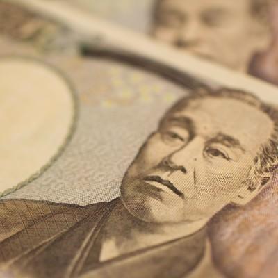 「重ねた壱萬円札」の写真素材