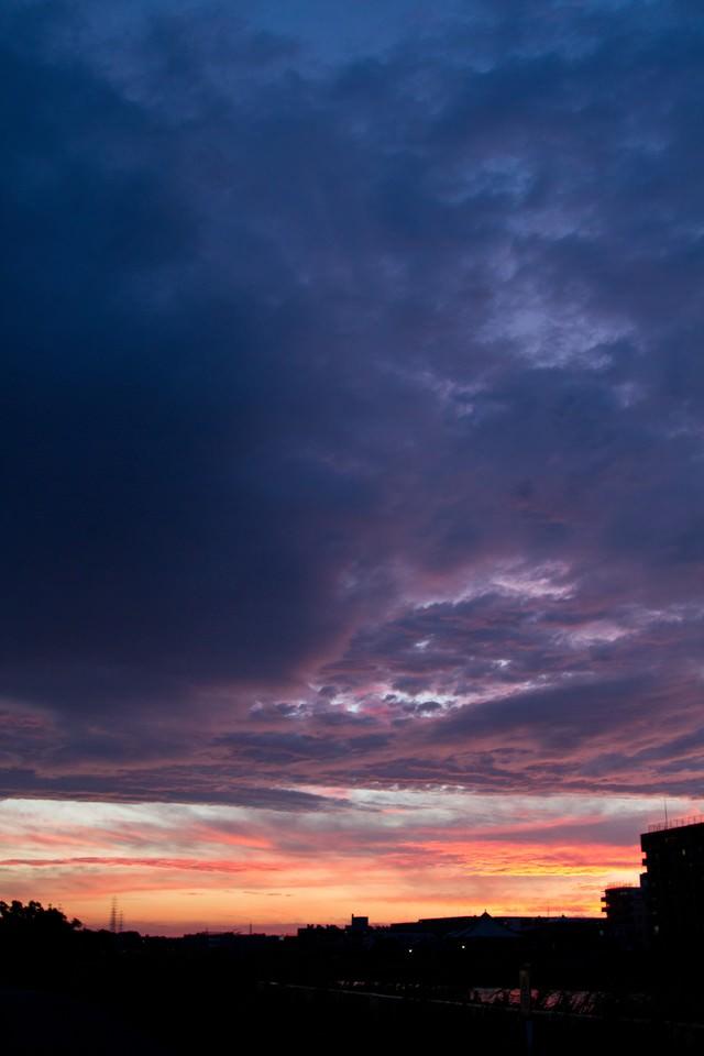 夕暮れのオレンジ空の写真