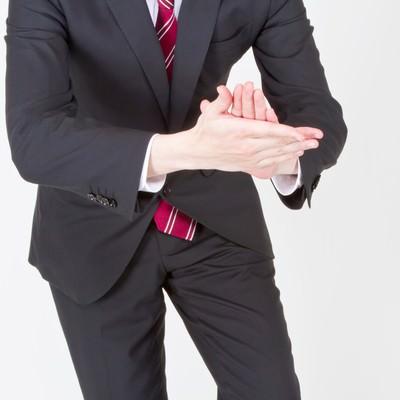 「「イヨッ!社長」っとおべっかを使うサラリーマン」の写真素材