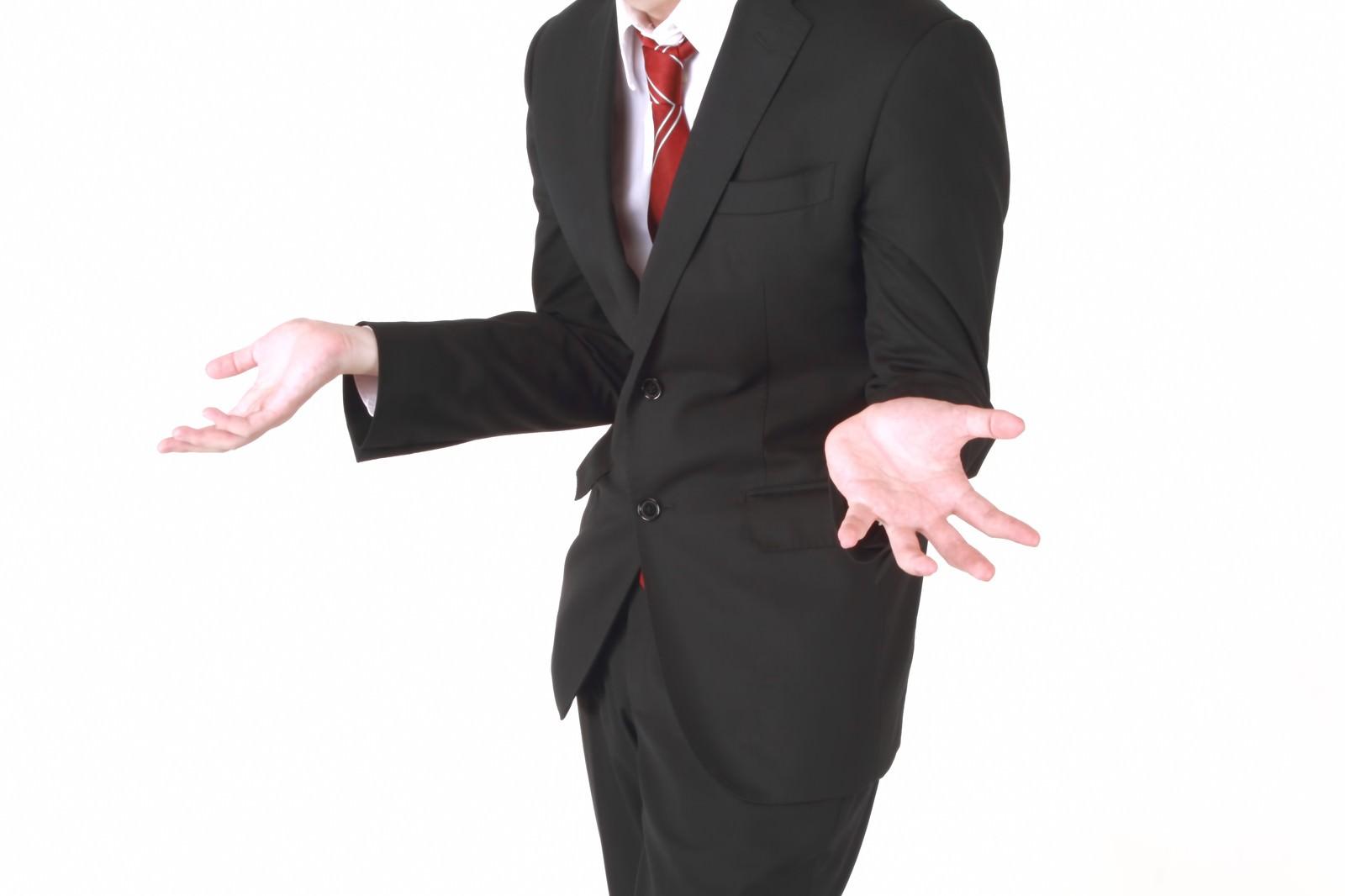 「「why?」のジェスチャーをするビジネスマン」