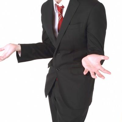 「「why?」のジェスチャーをするビジネスマン」の写真素材