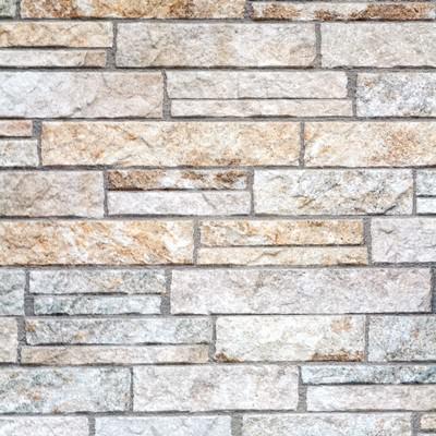 「ごつごつしたタイルの壁」の写真素材