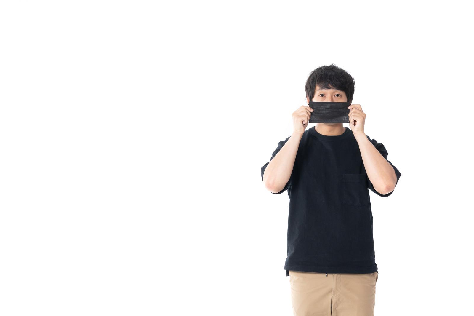 「顔出しNGの黒マスクマン」の写真[モデル:大川竜弥]