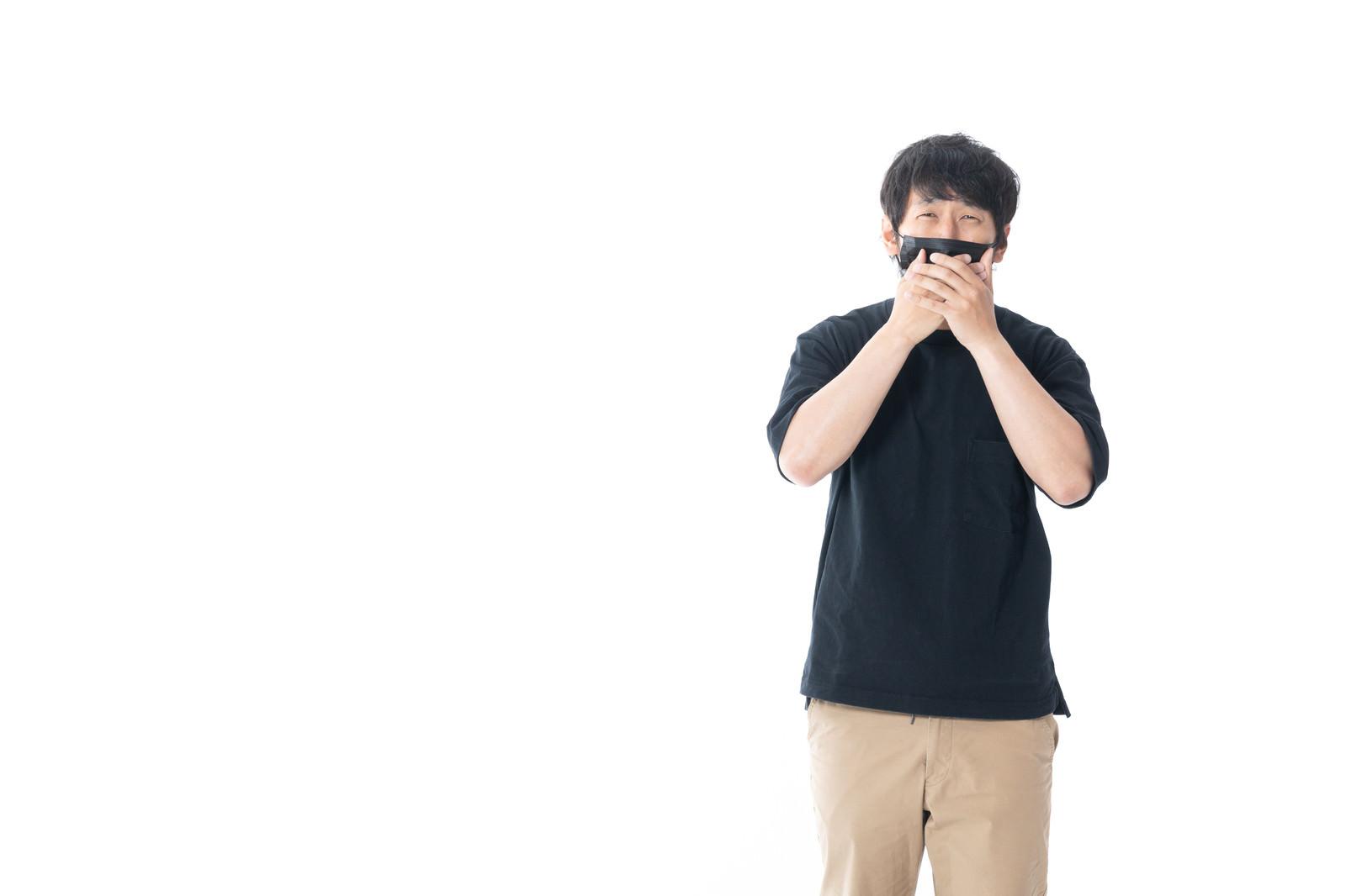 「嘲笑するマスク男」の写真[モデル:大川竜弥]