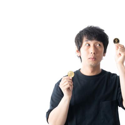 ボラが大きいアルトコイン(ETH)に投資を決めた男性の写真