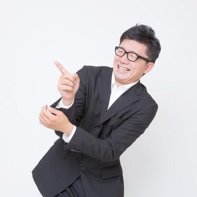 「「面白い!」っと指さすビジネスマン」の写真素材
