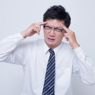 「頭痛が痛い」の写真素材